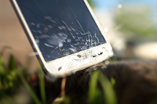 cracked smartphone screen on grass